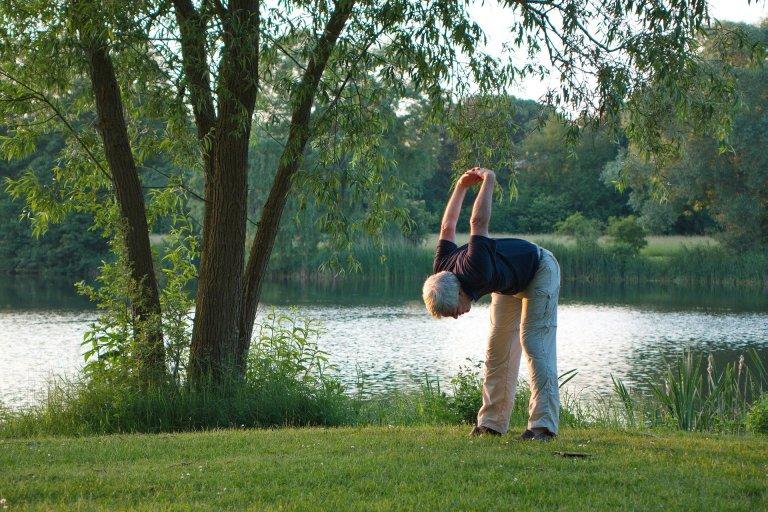 man doing yoga outside